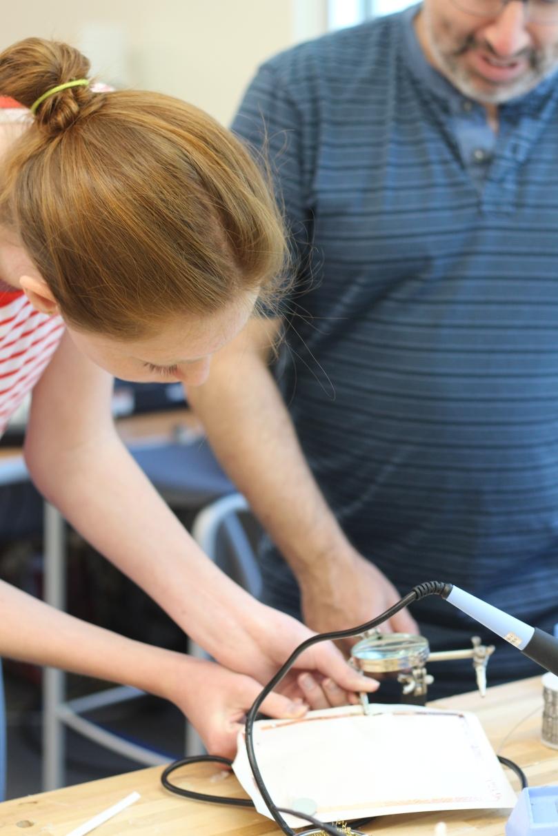 student soldering
